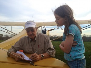Geoff Nye filling in Ana's logbook.